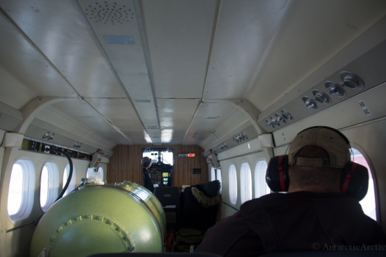 Inside the Twin Otter - the pilots up front, then the ferry fuel tank (extra fuel for the long flight) and us in the back.